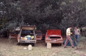 My car on the left as Greg Tripplet and Warren Doubleday prepare their tent for a wild night of drinking.